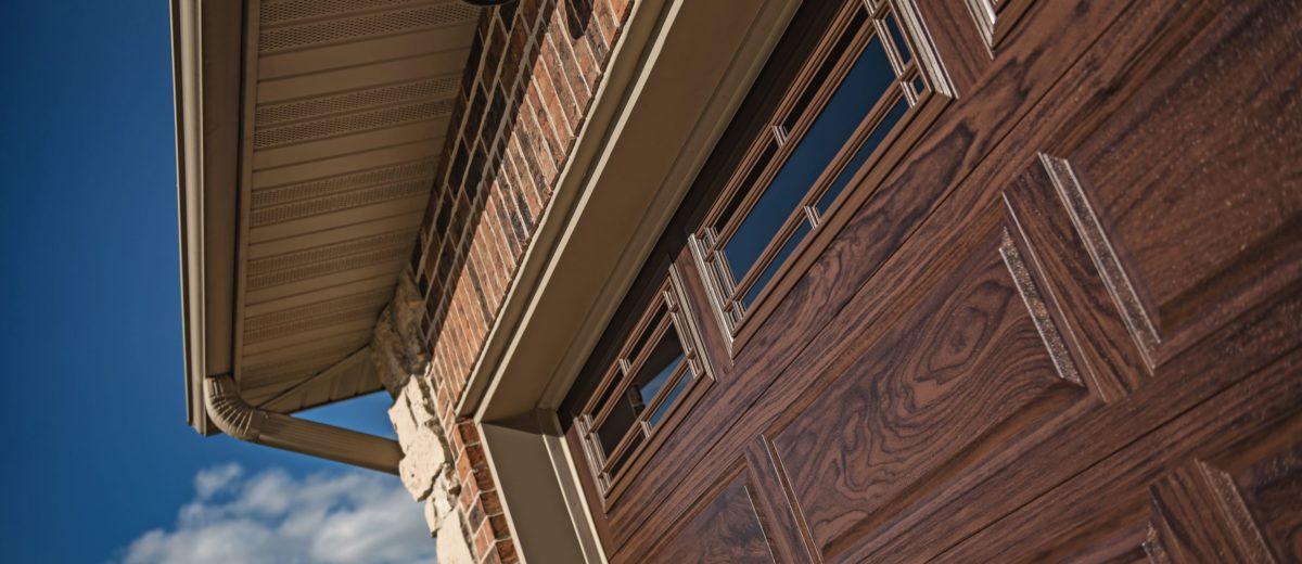 Raised Panel Walnut Wood Accent Garage Door